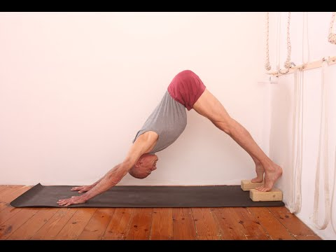 How to elevate he pelvis and extend the spine in Adho Mukha Svanasana (Downward Facing Dog Pose)